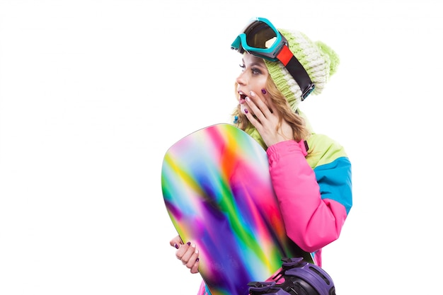 Young woman in ski suit with snowboard Premium Photo