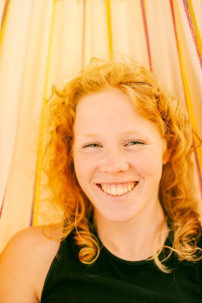 Young woman smiling while looking at camera Free Photo