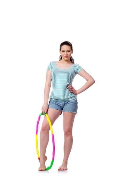 Young woman in sports concept isolated on the white Premium Photo
