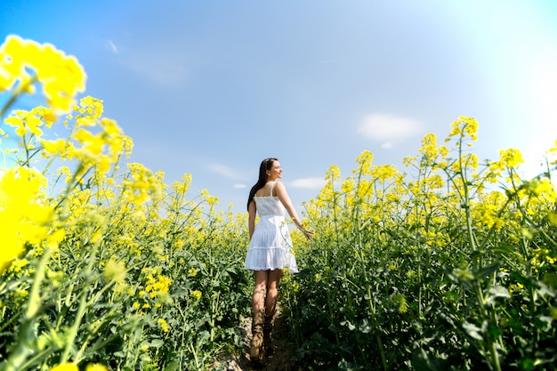 Young woman in the spring field Premium Photo