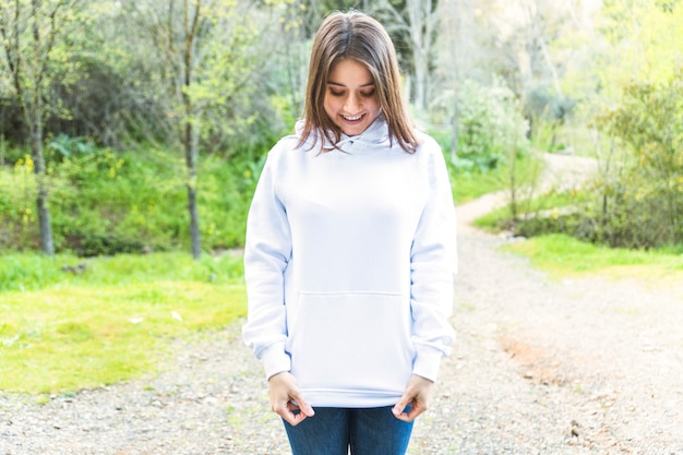 Young woman standing in forest Free Photo