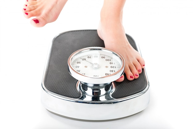 Young woman standing on a scale Premium Photo
