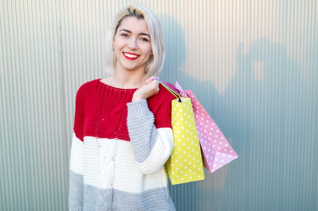 Young woman standing in a shopping center while looking to camera Premium Photo