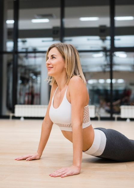 Young woman stretching at the gym Free Photo
