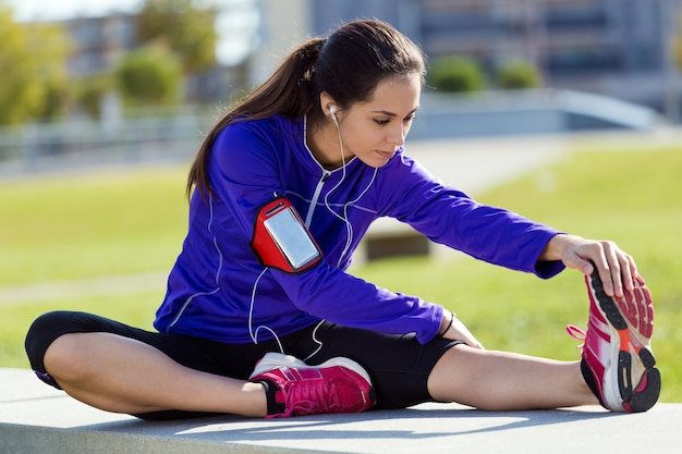 Young woman stretching and preparing for running Free Photo