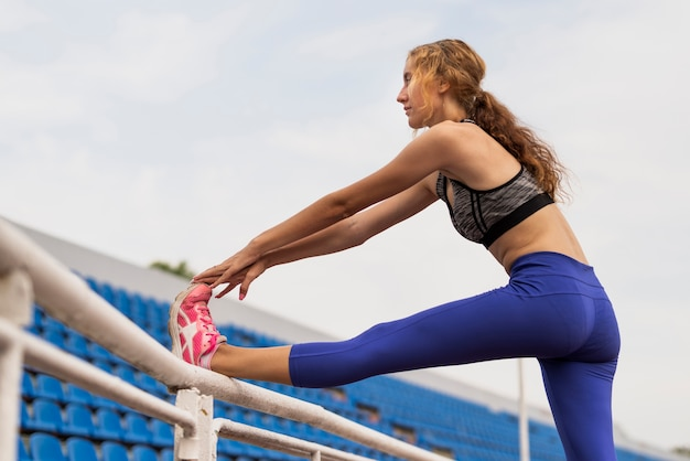 Young woman stretching process Free Photo