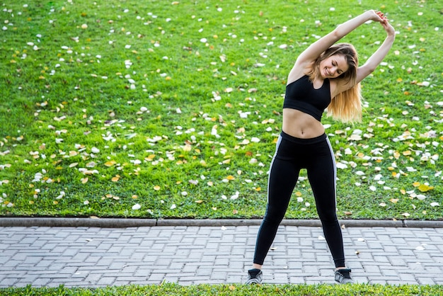 Young woman stretching at the street Free Photo