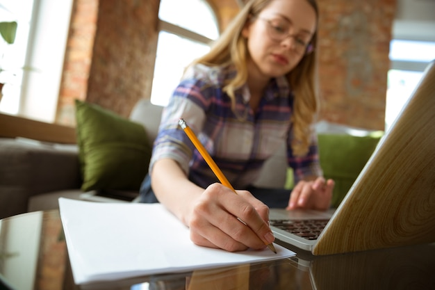 Young woman studying at home during online courses or free information by herself making notes Free Photo