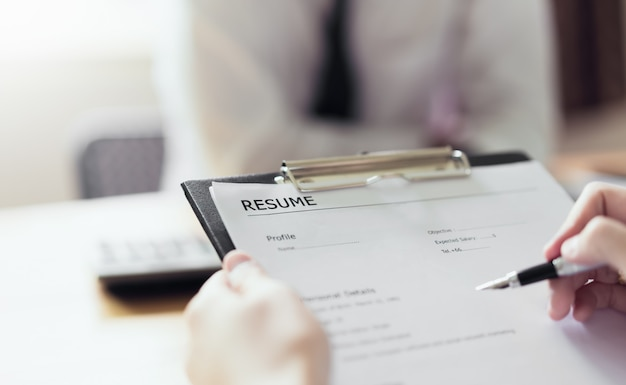 Young woman submit resume employer to review job application. Premium Photo