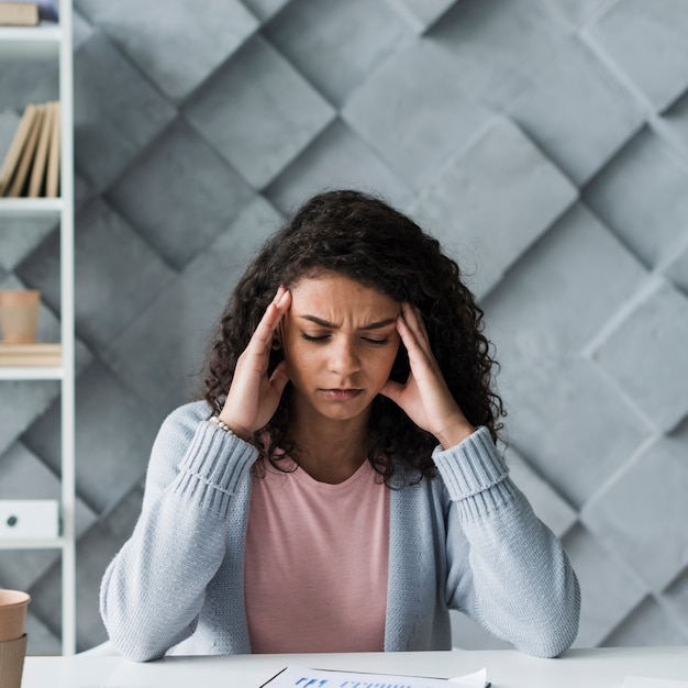 Young woman suffering from headache Free Photo