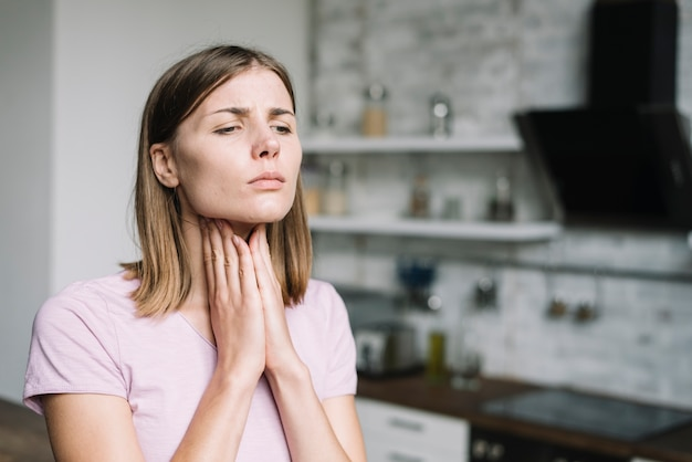 Young woman suffering from throat pain Premium Photo