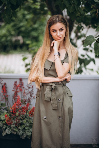 Young woman in summer outfit outside cafe Free Photo