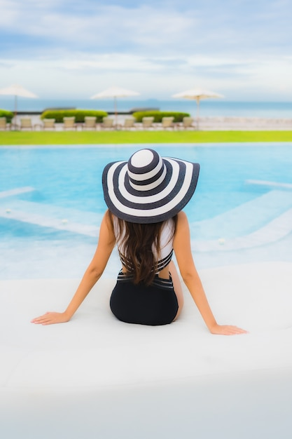 Young woman in the swimming pool Free Photo