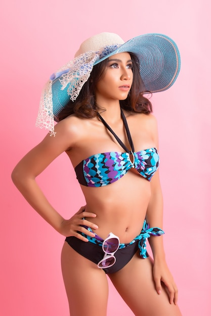 Young woman in swimwear isolated over pink Free Photo