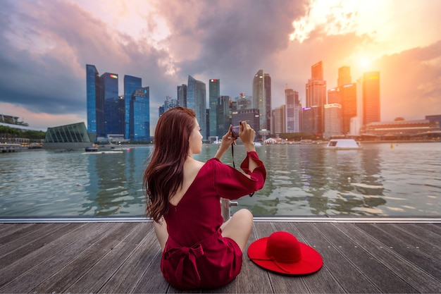 Young woman take a photos in singapore. Free Photo