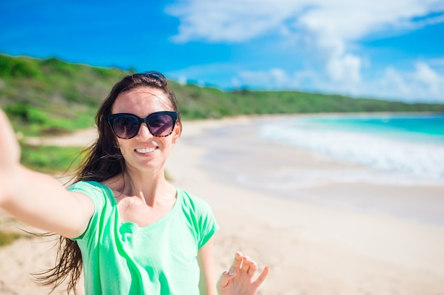 Young woman taking selfie portrait on the beach Premium Photo