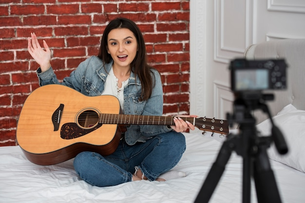 Young woman teaching how to play guitar Free Photo