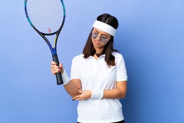 Woman experiencing a tennis elbow injury