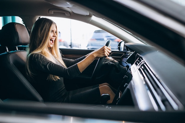 Young woman testing a car from a car showroom Free Photo