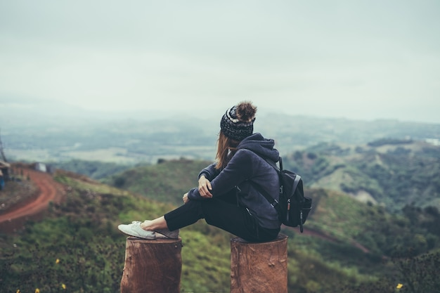 Young woman traveler sitting and looking view of nature Premium Photo
