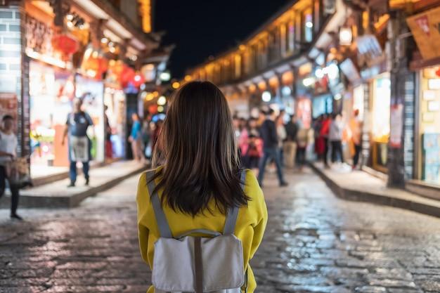 Young woman traveler walking at lijiang old town in china, travel lifestyle Premium Photo