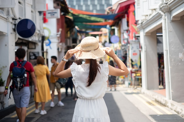 Young woman traveling with white dress and hat Premium Photo
