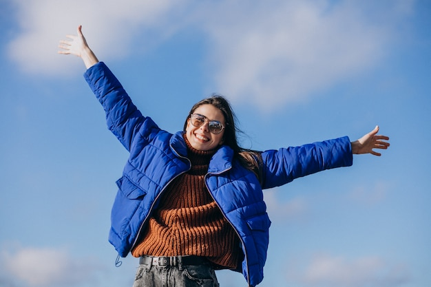 Young woman traveller in blue jacket Free Photo
