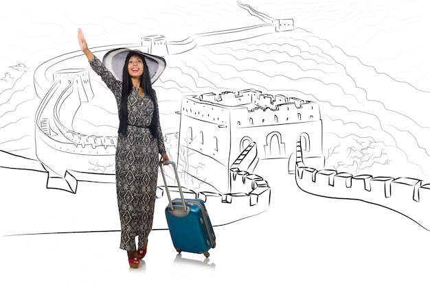 Young woman travelling to china to see great wall Premium Photo