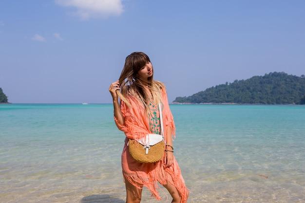 Young woman in trendy boho beach dress Free Photo
