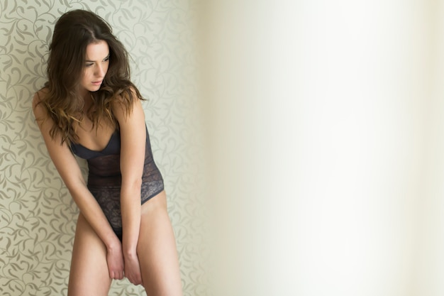 Young woman in underwear in the room Premium Photo