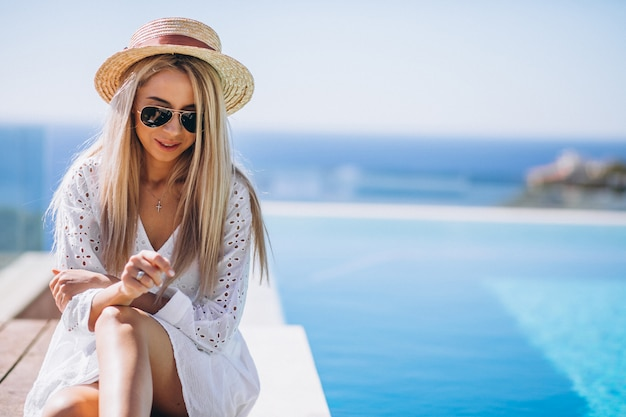 Young woman on a vacation by the pool Free Photo