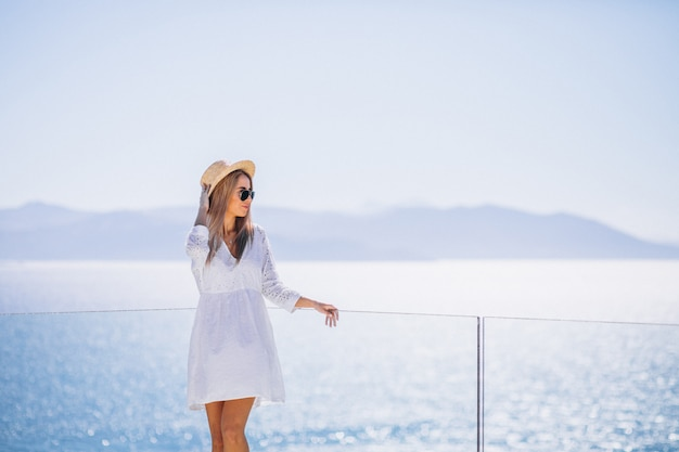 Young woman on a vacation looking at the sea Free Photo
