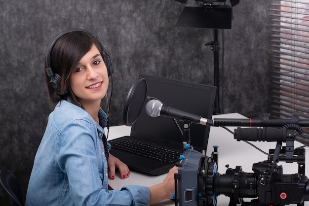 Young woman video editor working in studio Premium Photo