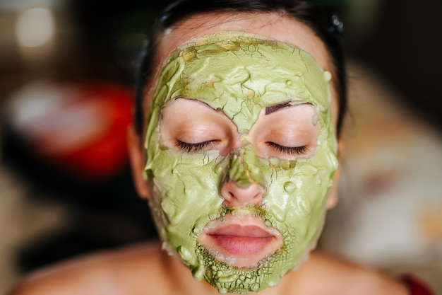 Young woman wearing a facial mask. skin care concept Premium Photo