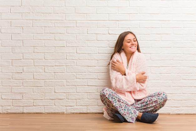 Young woman wearing pajama giving a hug Premium Photo