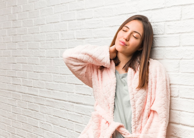 Young woman wearing pajama suffering neck pain Premium Photo