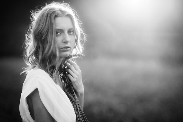 Young woman in wheat field Premium Photo