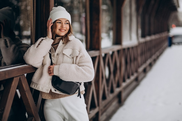 Young woman in winter outfit outside the street Free Photo