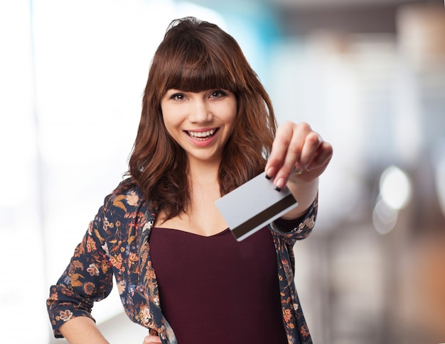 Young woman with credit car Free Photo