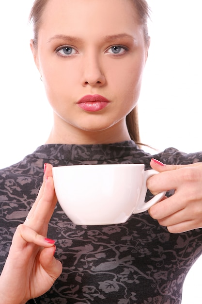 Young woman with a cup of hot coffee Free Photo