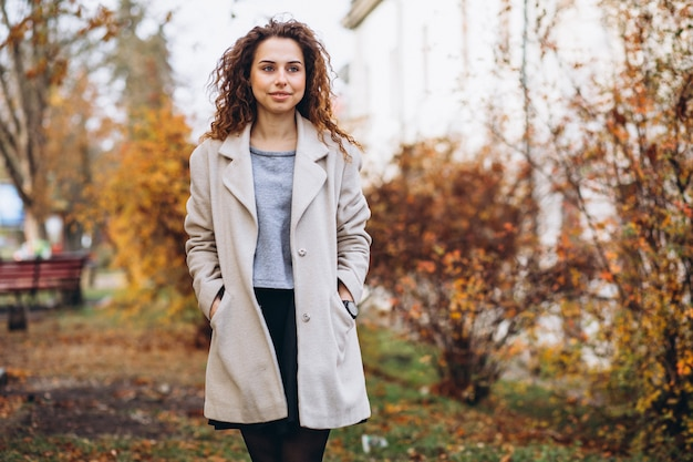 Young woman with curly hair in park Free Photo