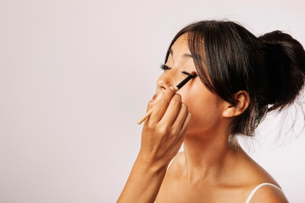 Young woman with eye make up Free Photo