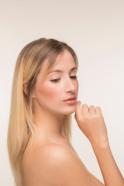 Young woman with hand on the chin pose Free Photo