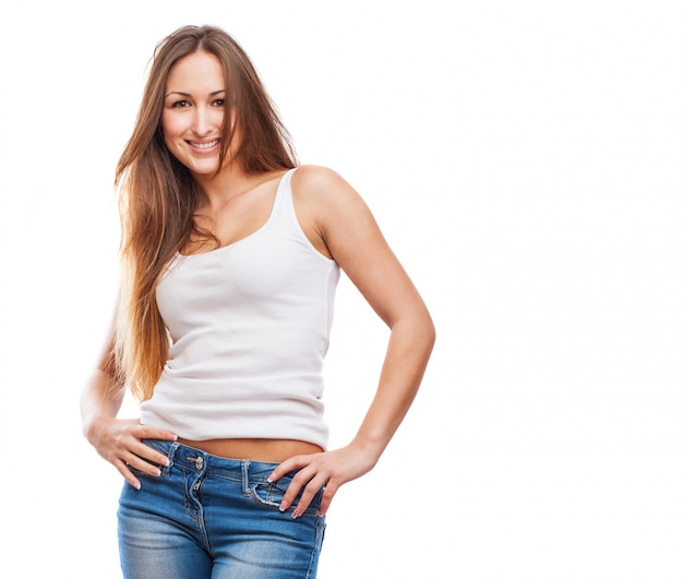 Young woman with her hands on hips Free Photo