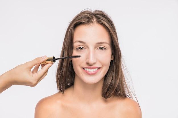 Young woman with lash mascara Free Photo