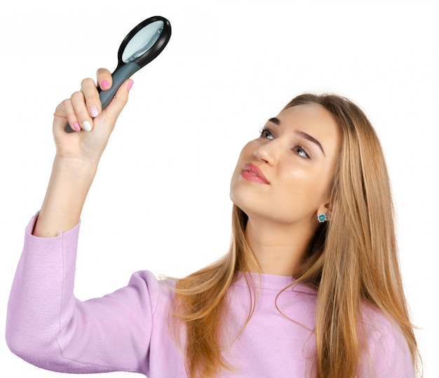 Young woman with magnifying glass Premium Photo