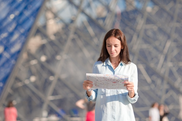 Young woman with map in european city outdoors Premium Photo