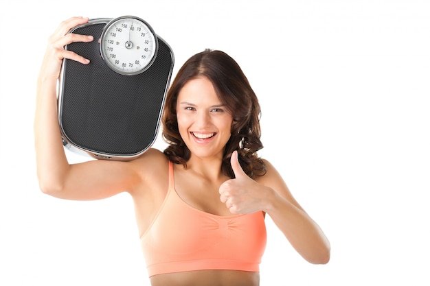 Young woman with measuring scale Premium Photo