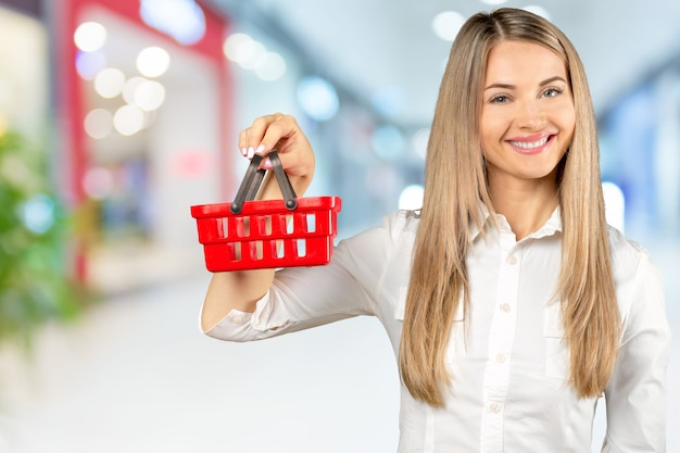 Young woman with a miniature shopping cart Premium Photo