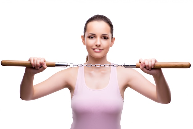 Young woman with nunchucks isolated on white Premium Photo